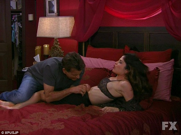 Racy scene: Selma strips down to her black lacy bra in the scene, as Charlie attempts to unzip her skirt