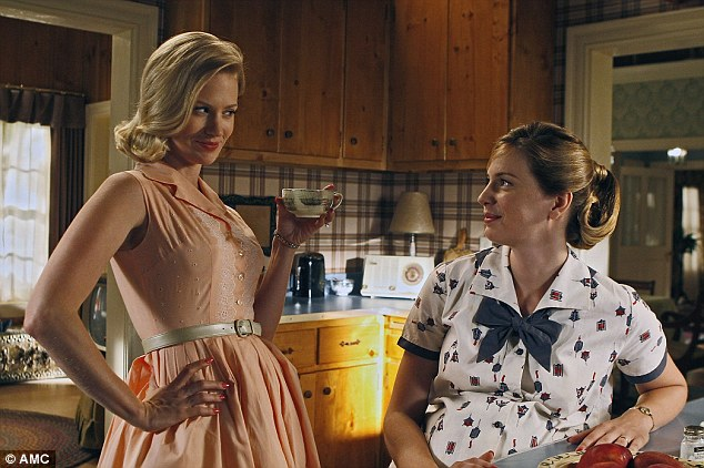 Immaculate look: January Jones, left, plays perfect housewife Betty Draper in Mad Men but many real women of the era wouldn't have had time to look as groomed as she does