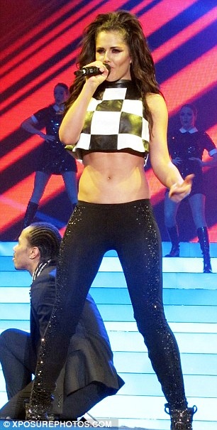 Tip top condition: Cheryl in action on the Girls Aloud Ten Tour which hits London on Friday