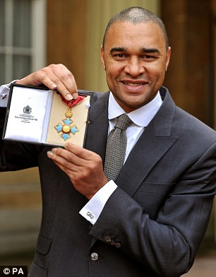 Stepping down: Elliott became the first black footballer to receive a CBE last month