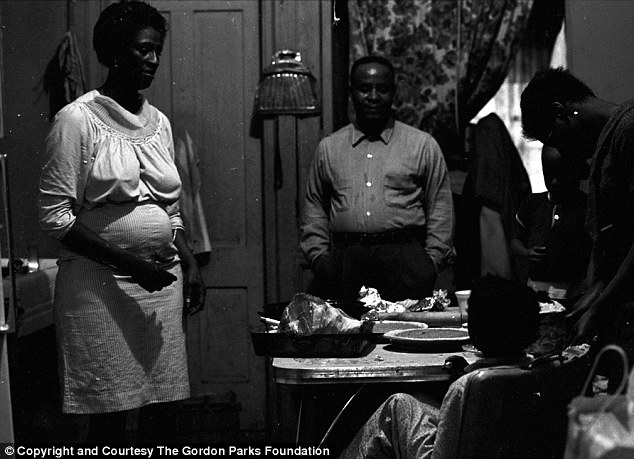 Dinner time: The picture shows dinner time at the Fontenelle home where Gordon Parks spent a month