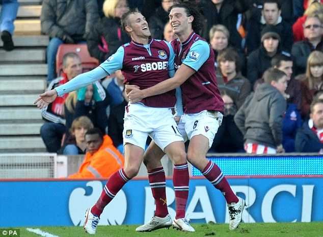 Winner: Jack Collison slots home the only goal of the game for West Ham and celebrates (below)