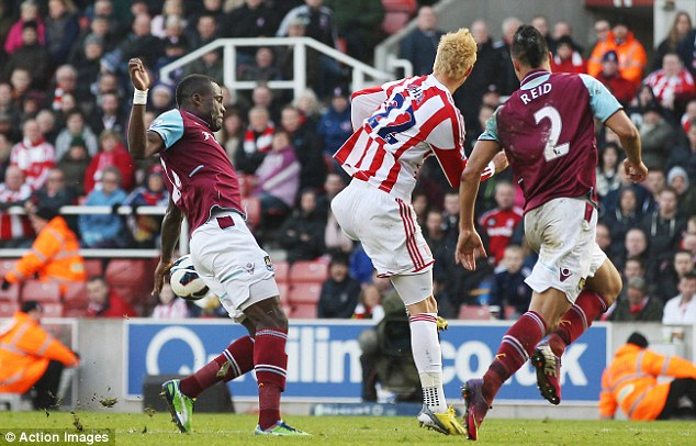 Claim: West Ham's Guy Demel (left) appears to handle the ball inside the penalty area