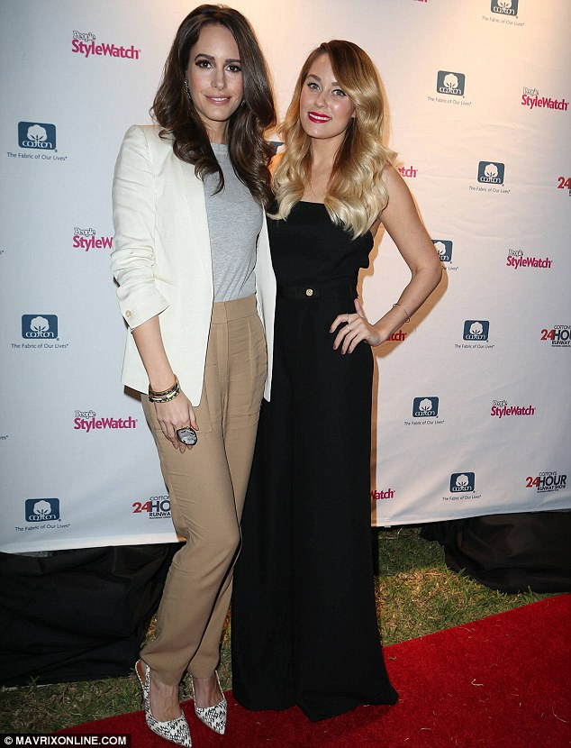 Double act: Lauren and Louise seemed to revel in showing off their outfits on the red carpet
