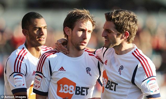 Killer touch: Craig Dawson (centre) celebrates his winning goal for Bolton