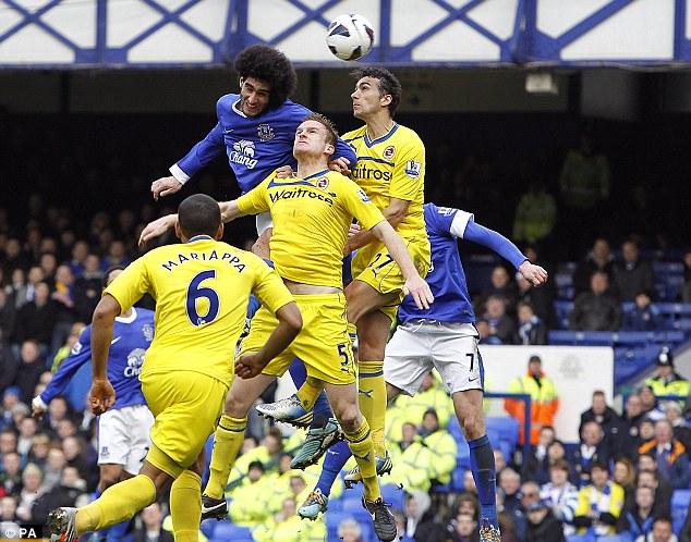 High life: Everton's Marouane Fellaini rises to head the opener