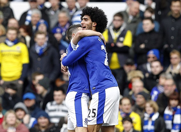 Hair raising: Marouane Fellaini celebrates scoring the opening goal