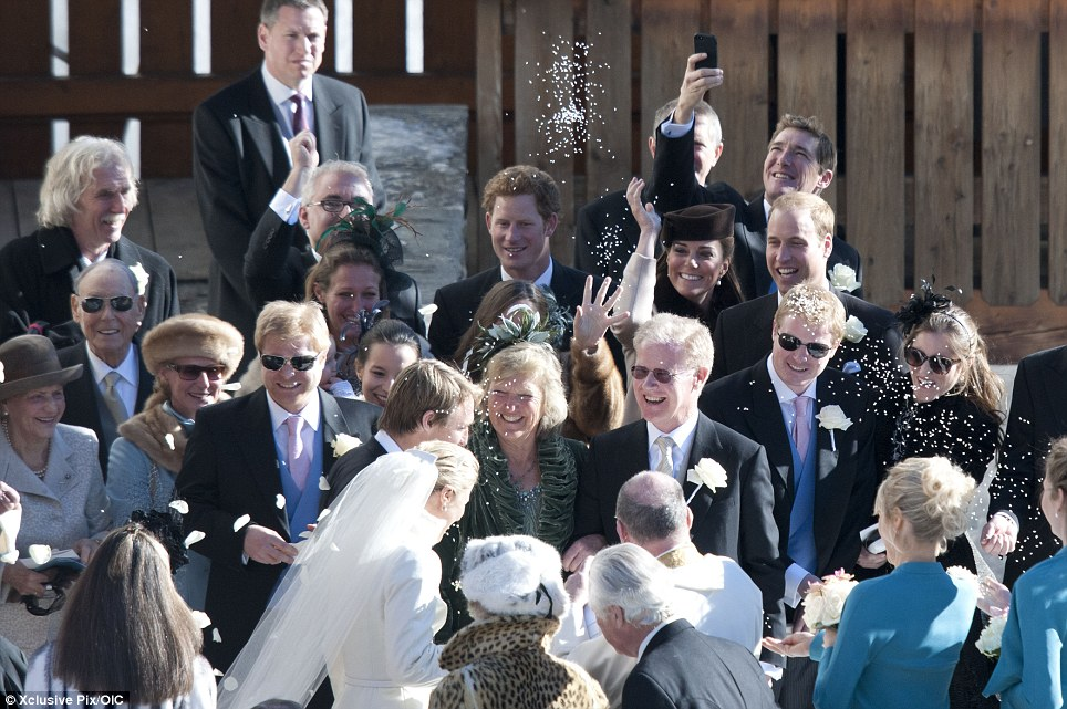 Fun: A clearly delighted Kate even throws some confetti into the air at the happy couple walk past them