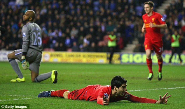 Flying high: Luis Suarez ran Wigan into the ground as Liverpool ran away easy winners