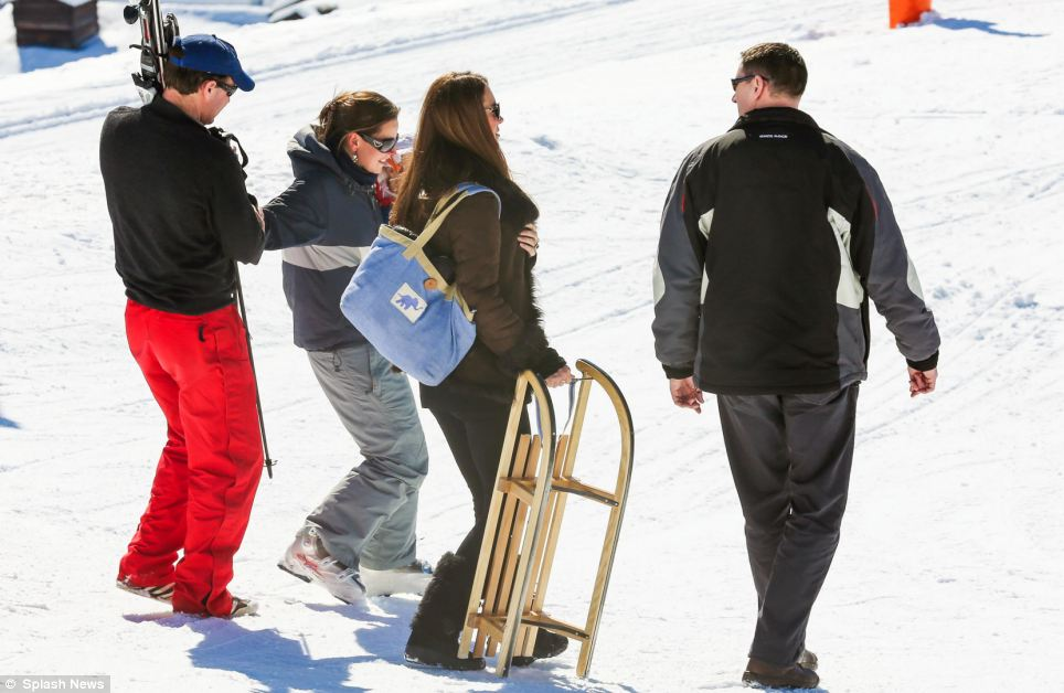 On the go: The Duchess pulls a sled along the snow as she enjoys her break
