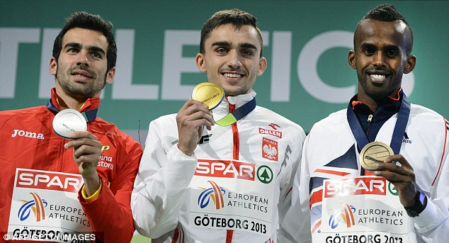 Proud moment: Mohammed shows off his bronze medal after finishing behind Poland's Adam Kszczot and Spain's Kevin Lopez