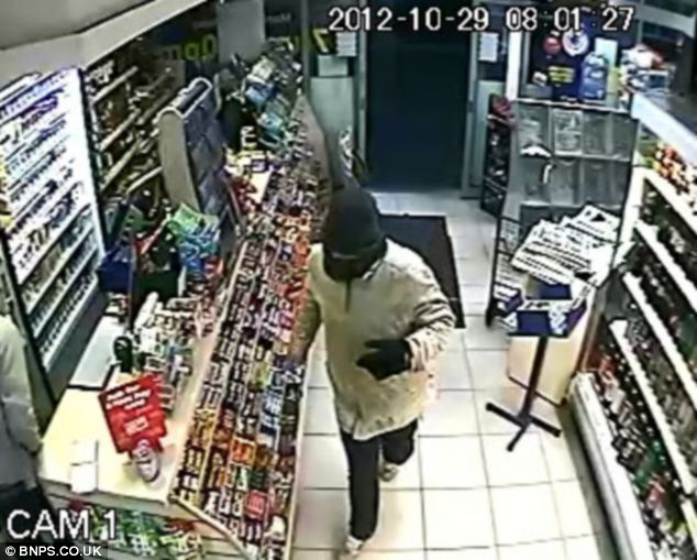CCTV footage shows Nicholas Smith storming into Poole Convenience Store in Dorset and demanding money