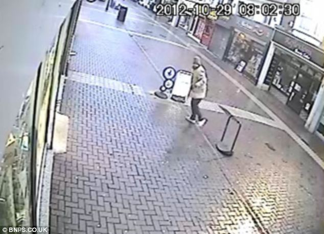Nicholas Smith is caught on camera fleeing the scene after the attempted robbery