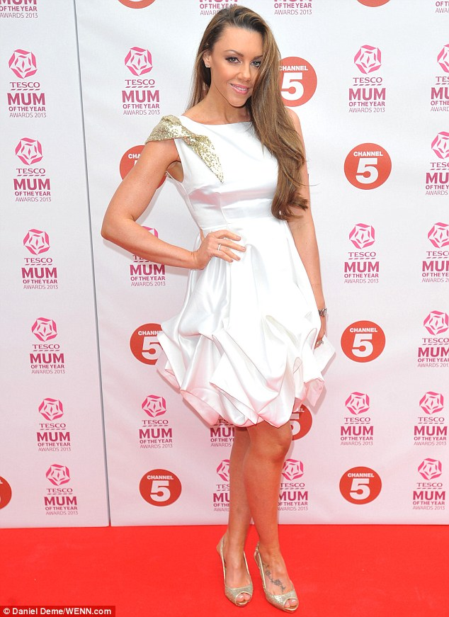 All white on the night: The Liberty X singer dazzled in a dramatic white ruffle-hem minidress