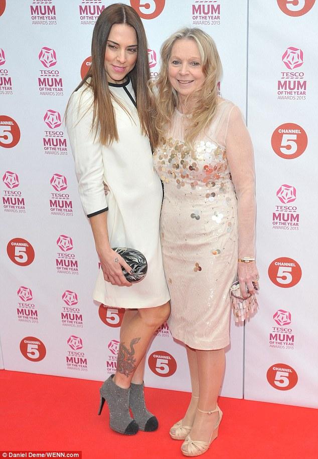 Mum's the word: Mel C celebrated winning Tesco Celebrity Mum of the Year alongside her glamorous mother, Joan O'Neill, at The Savoy hotel on Sunday