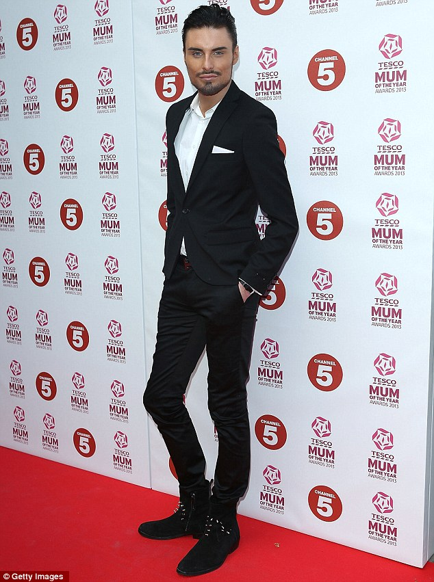 Dapper dude: Rylan Clark looked stylish in a tailored black suit as she posed up a storm on the red carpet