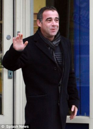 Waving: Le Vell gives a wave on Friday as he appears to leave the bookmakers