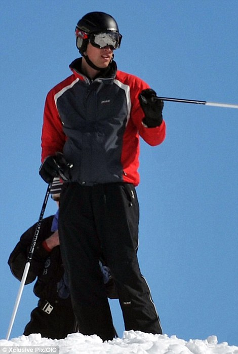 Princes William and Harry skiing on the slopes  after attending a wedding ceremony