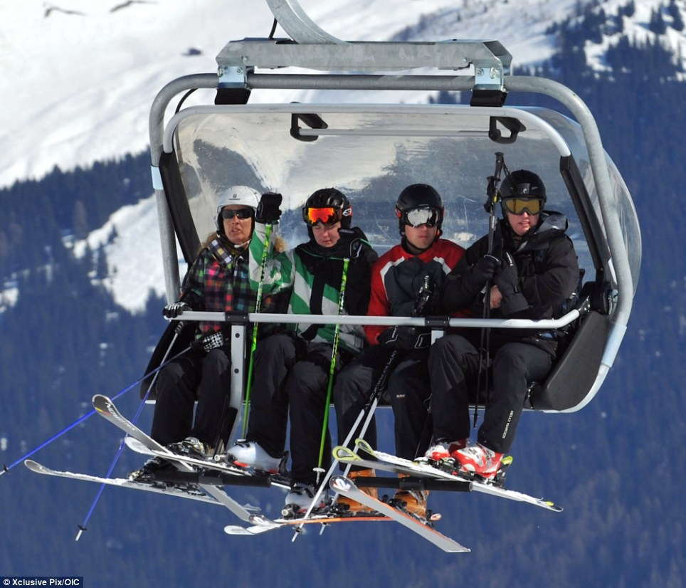 Royal carriage: Prince William, second from right, takes the cable car to the top of the Swiss mountain at the Arosa luxury resort as he enjoys a day of skiing