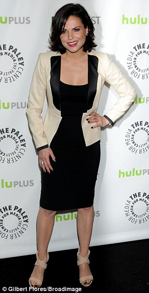 Good girl gone bad: Lana Parrilla, who plays the Wicked Queen, donned a figure hugging cocktail length little black dress and a cream and black jacket with sky high cream platforms