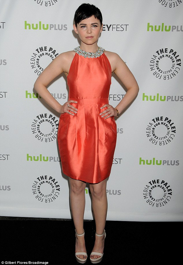 Stand out: Ginnifer glowed in a her short orange gown which featured a bejeweled high neckline