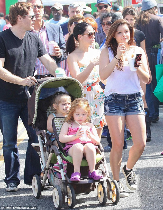 One foot ahead: The Modern Family star took charge, leading the way during their Sunday outing