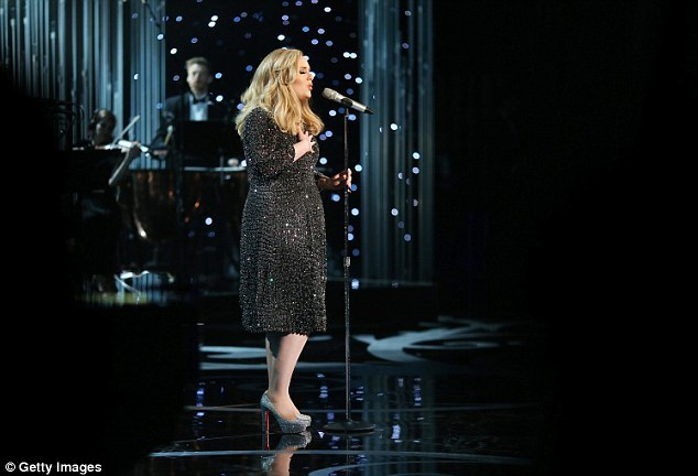 Star performer: All of Adele's family stayed up to watch the Oscars as she performed her hit Skyfall song and won an award for it