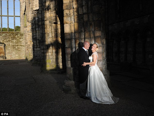 Happy couple: Zara Phillips and Mike Tindall in Holyrood Abbey, Scotland, on their wedding day in July 2011 but they are yet to have any children