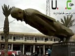 Another one bites the bust! Syrian rebels tear down statue of President Assad's father as they capture northeastern city