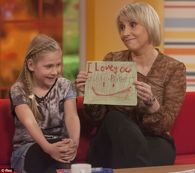 Not a fan anymore: Louise Cooper had taken her daughter to the concert, but the little girl scribbled over her pledge of love for the singer after the disappointing event