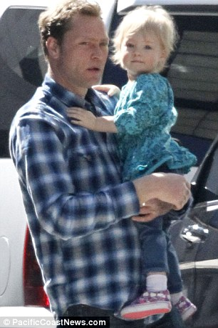 Family affair: The actress' husband Martyn LeNoble and their daughter Sadie made a visit to the set
