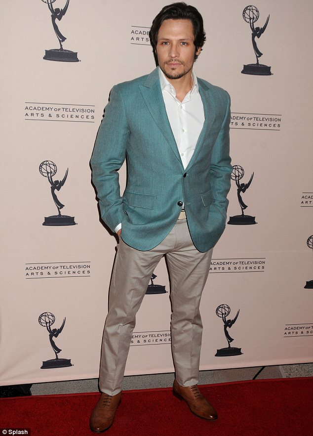 Making a fashion statement: Nick Wechsler stood out in a green jacket over a white shirt, beige chinos and brown brogues