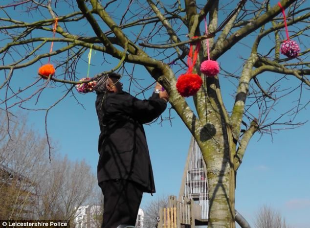 Warding off crime: Local people have been encouraged to donate woolly decorations to the scheme