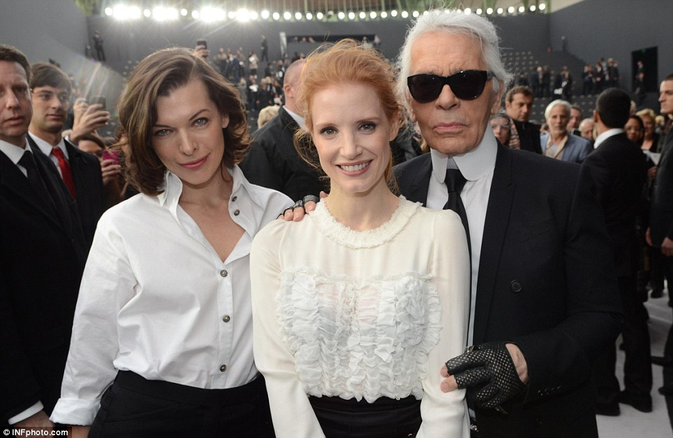 Celeb support: Milla Jovovich, left, and Jessica Chastain sat on the front row and met creative designer Karl Lagerfeld after the show