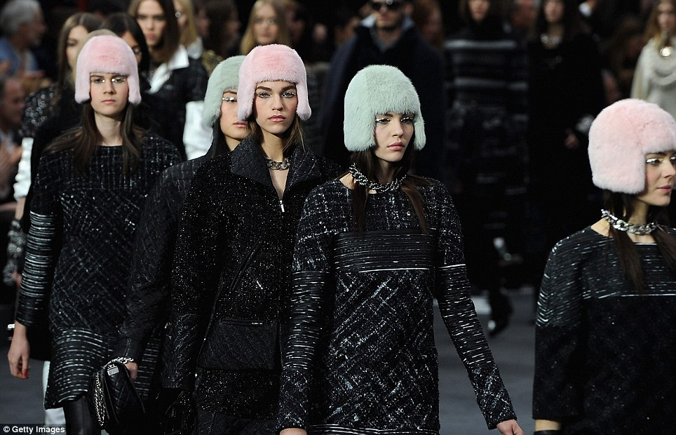 Wrapped up: The furry hats came in pastel colours to contrast the dark coats and suits