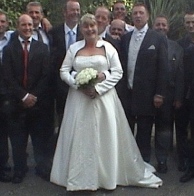 Tragic: Christie Marriott McHugh died last night following a row with a woman over a parking space outside the Lord Kitchener pub in Barnet, north London. She is pictured on her wedding day