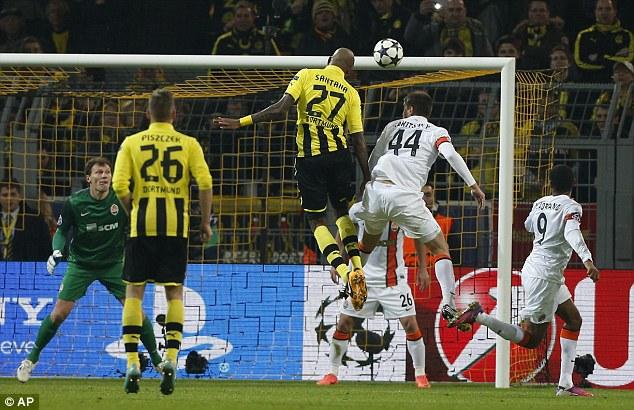 Climbing high: Felipe Santana scored a towering header to put Dortmund a goal up