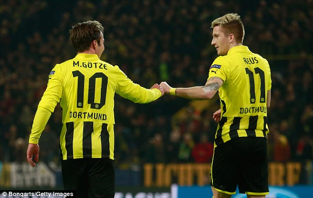 Congratulations: Marco Reus (right) touches base with Gotze