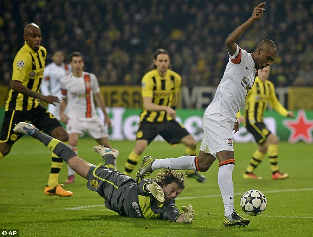 Called in to action: Dortmund's Roman Weidenfeller is rounded by Fernandinho (right)