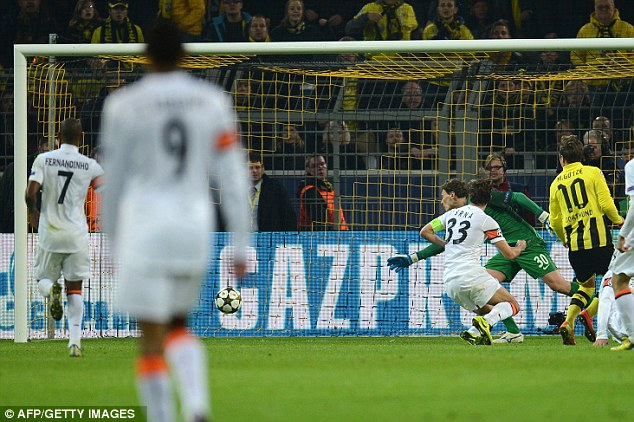 Just about: Gotze scuffed his attempt underneath Darijo Srna and into the back of the net