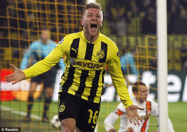 On the way: Jakub Blaszczykowski celebrates after scoring his side's third goal