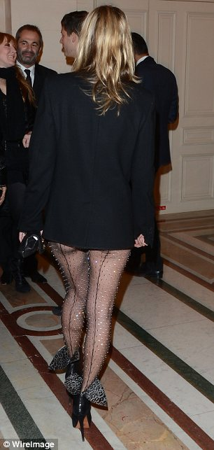Hitting a bum note: Kate's sheer all-in-one was decorated with diamante and showed off her model frame on Tuesday night