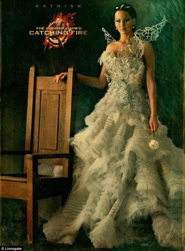 Spoils of victory: Jennifer Lawrence looks far from the scamp of old in her new portrait