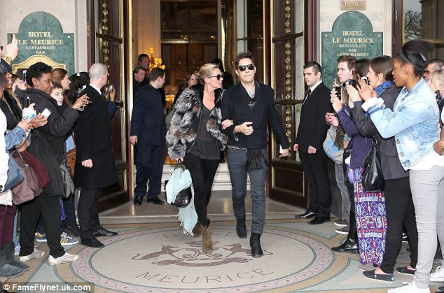 Causing a scene: Plenty of fashion fans were stood outside Kate's hotel waiting for her to emerge