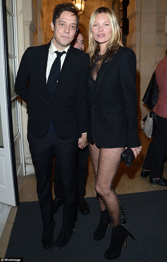 Joined by her other half: Moss beamed as she posed for a picture with husband Jamie Hince