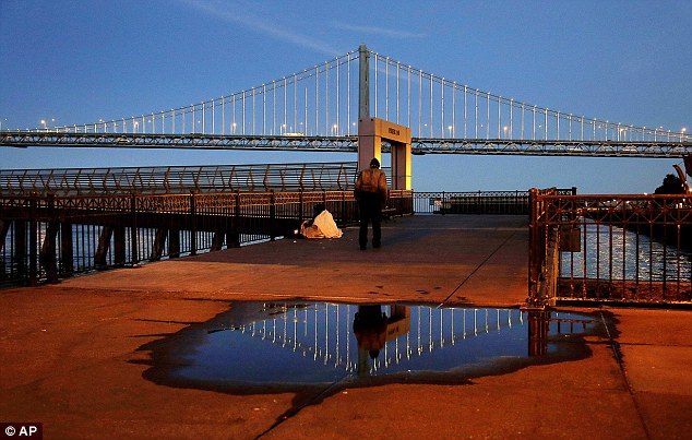 Illuminating: The lights are magnificently reflected on the San Francisco-Oakland Bay Bridge on Pier 14
