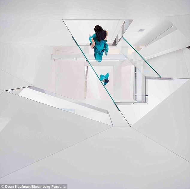 Don't look down: See-through floors in the attic let you view the third-story structural glass bridge and below
