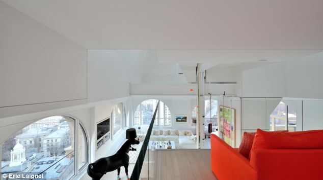 Views: The home has 32 windows that offer panoramic views from all four sides of the apartment