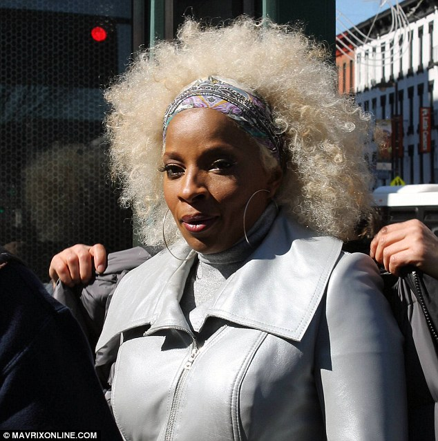 Big hair: The Grammy winner looked fabulous in her oversize head adornment