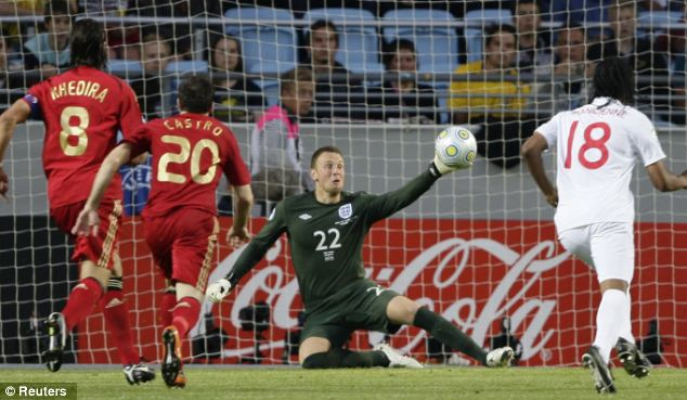 England's goalkeeper Scott Loach (C) is beaten by a shot from Germany's Mesut Ozil during their U21 European Championship finaL